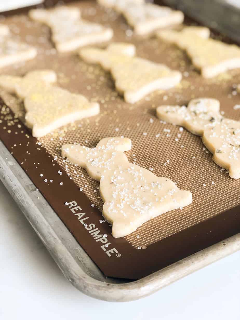 Lemon Lavender Shortbread cookies unbaked on a baking sheet lined with a silicon mat