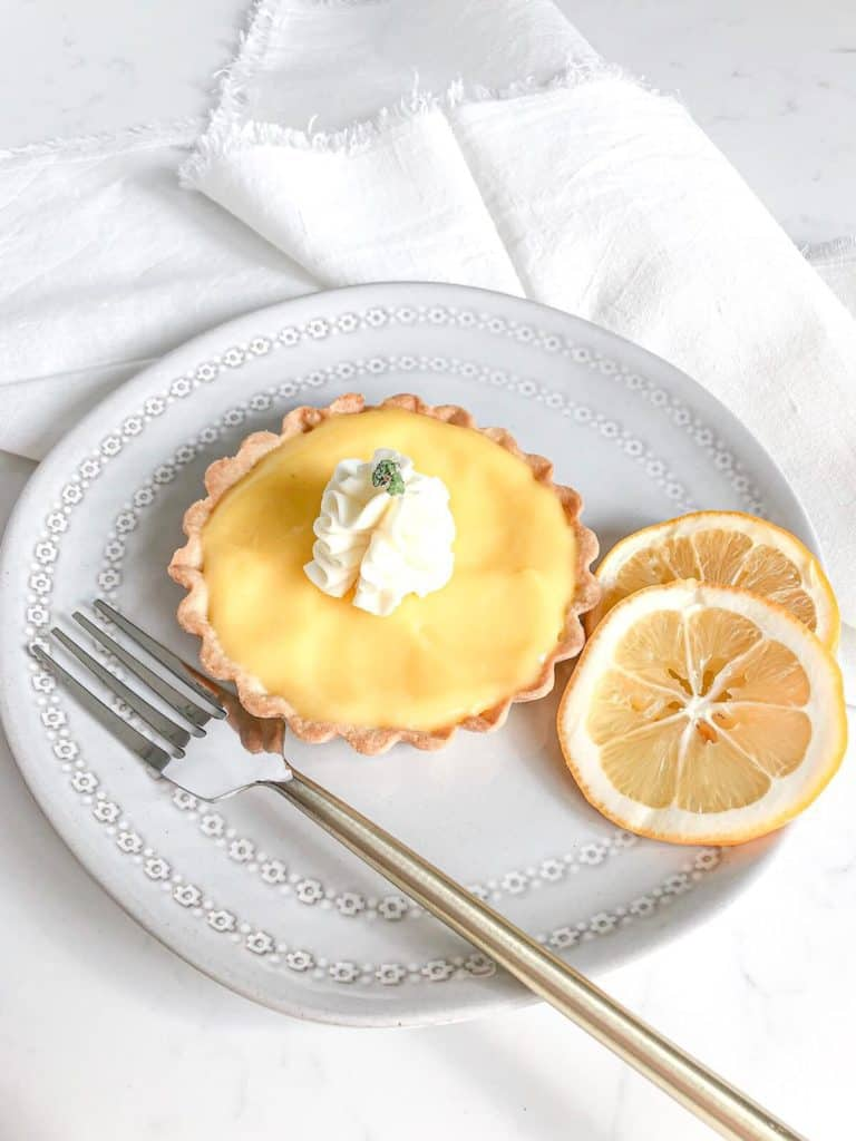 lemon tart on a plate with a fork