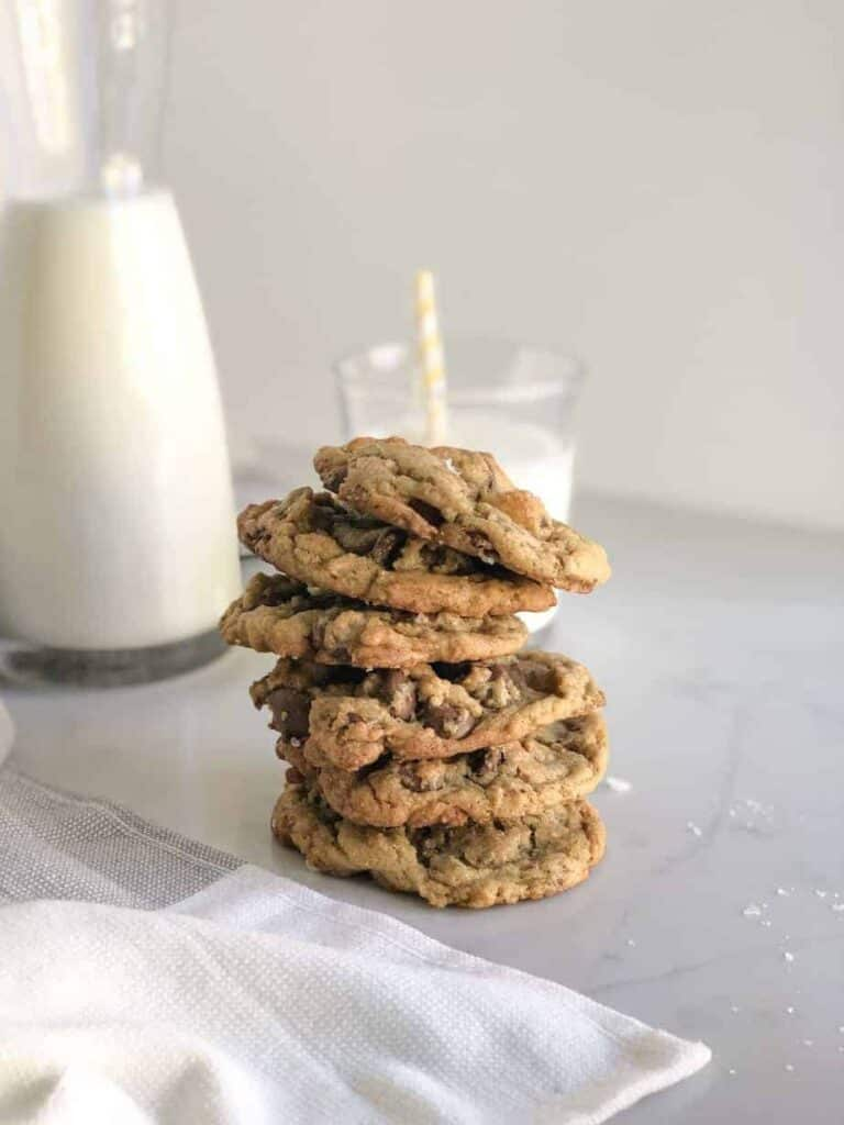 Stack of salted toffee chocolate chip cookies and milk