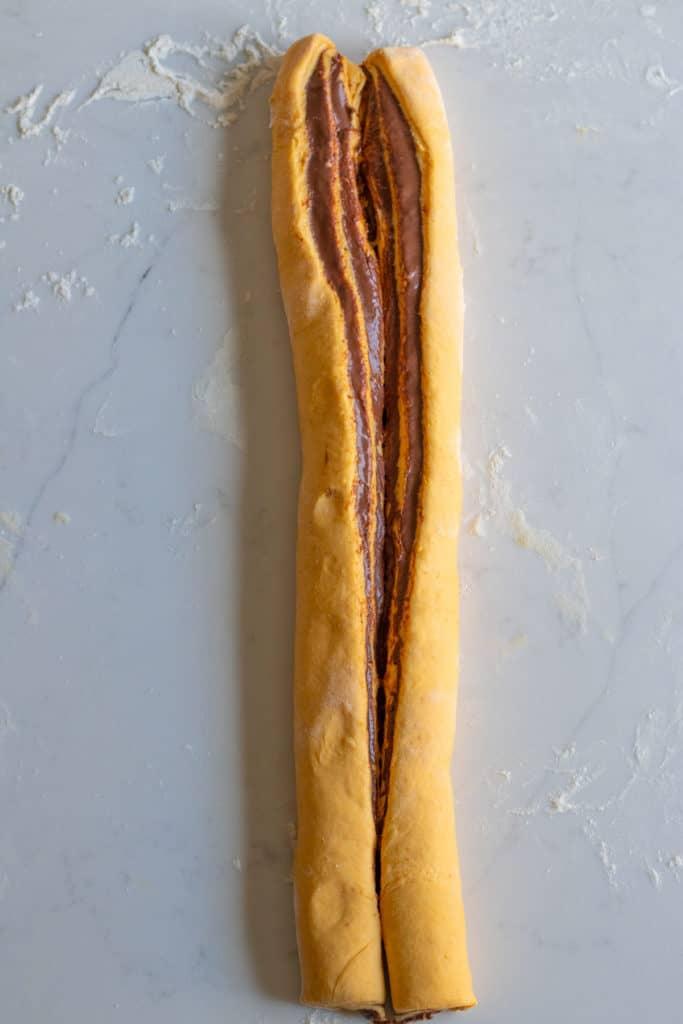 pumpkin babka dough rolled and sliced