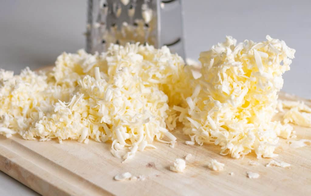 Frozen grated butter for on wood cutting board