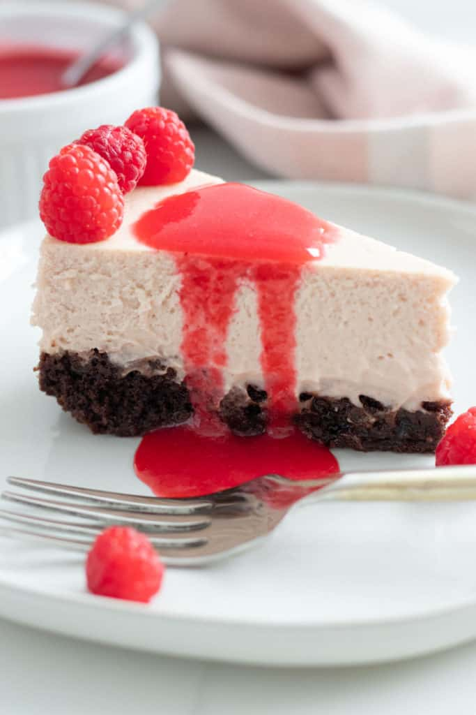 close up of slice of raspberry cheesecake