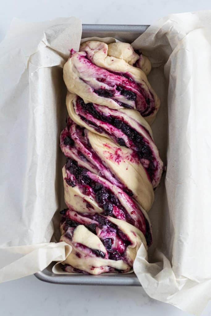 blueberry cream cheese babka in a loaf pan