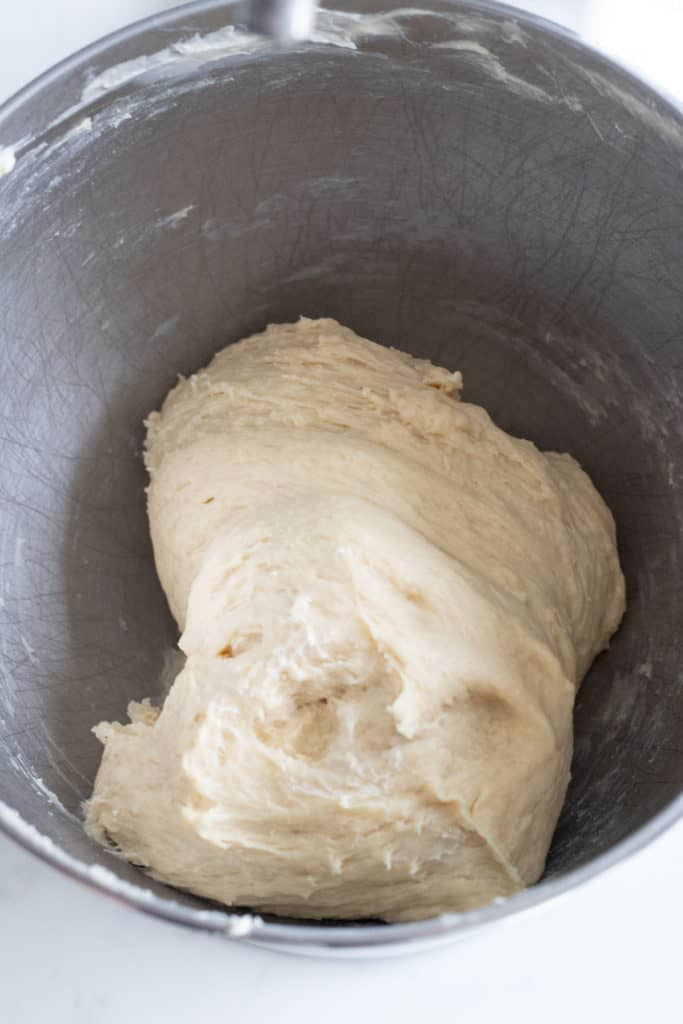 bowl of cinnamon roll dough before rising