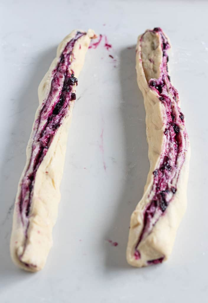 blueberry cream cheese babka dough sliced in half