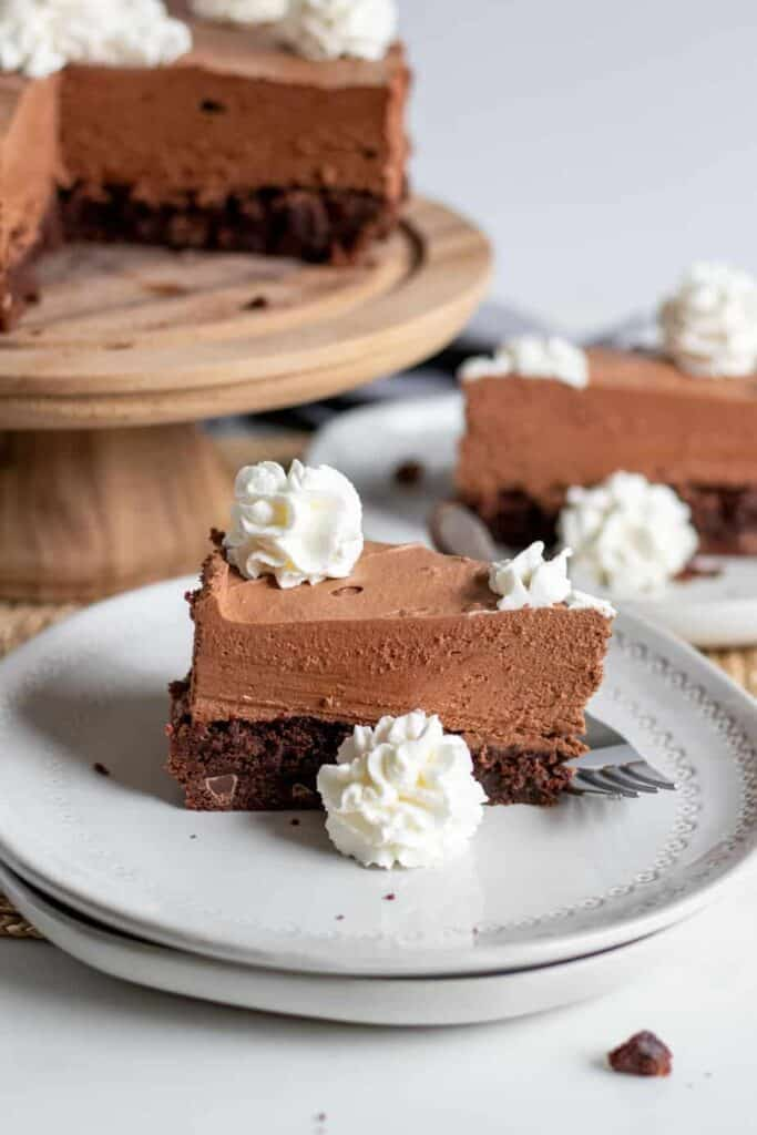 chocolate brownie mousse cake slice on plate