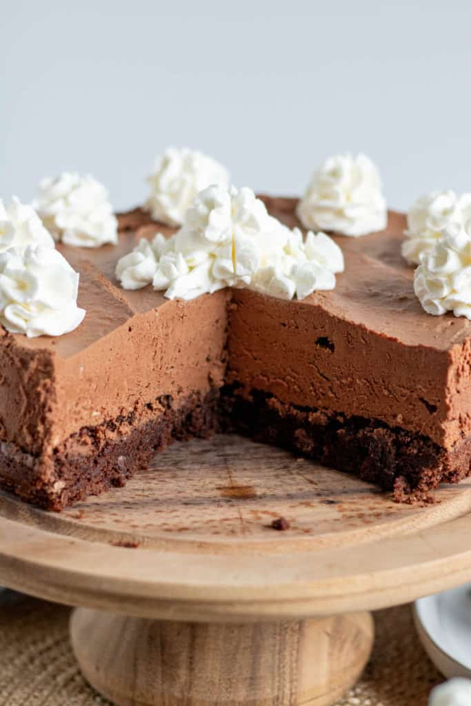 chocolate brownie mousse cake on a cake pedestal
