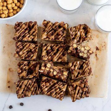 overhead shot of chocolate peanut butter cereal bars cut in squares