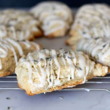 lavender scones glazed with vanilla icing on cooling rack