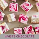 raspberry cheesecake bars scattered on parchment paper