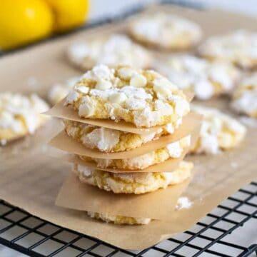 stack of lemon crinkle cookies on cooling rack