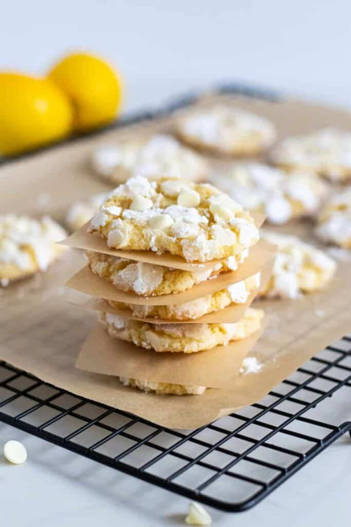 stack of lemon crinkle cookies on cooling rack