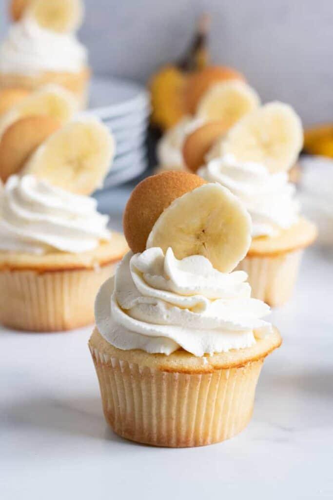 banana pudding cupcakes with sliced banana on top