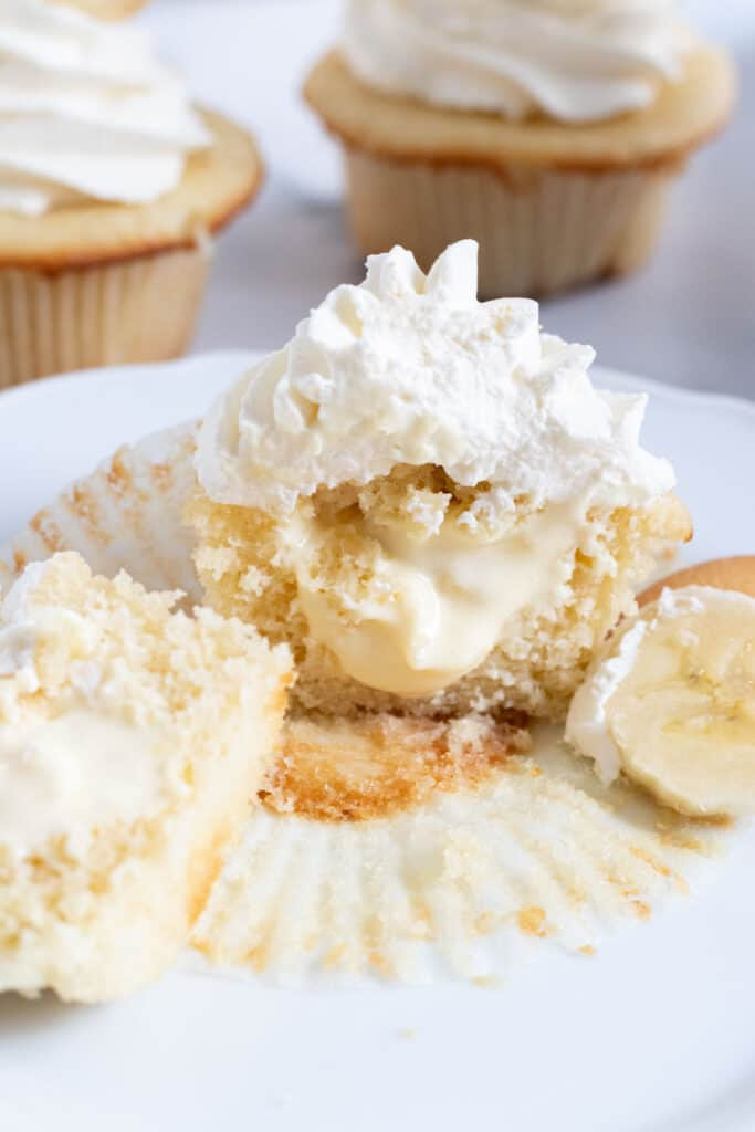 cupcake cut in half with banana pudding filling in center