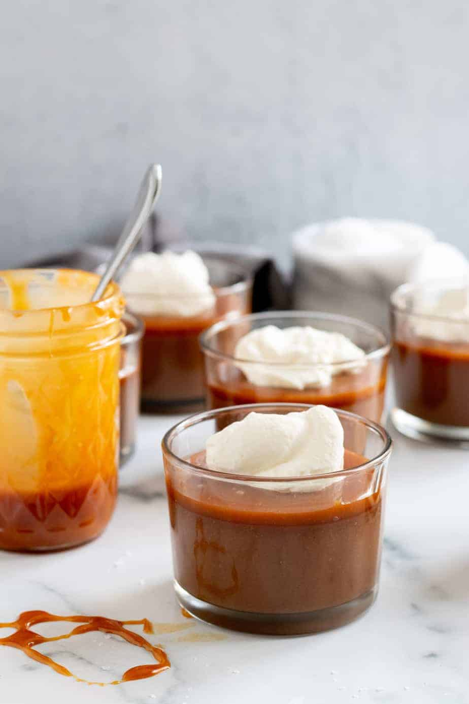 cups of chocolate budino with jar of salted caramel