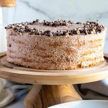 chocolate icebox cake on wood cake pedestal