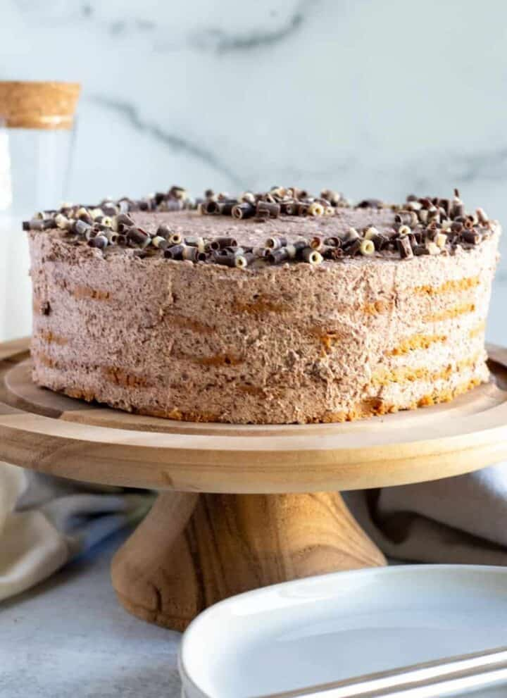 chocolate icebox cake on wood cake pedestal