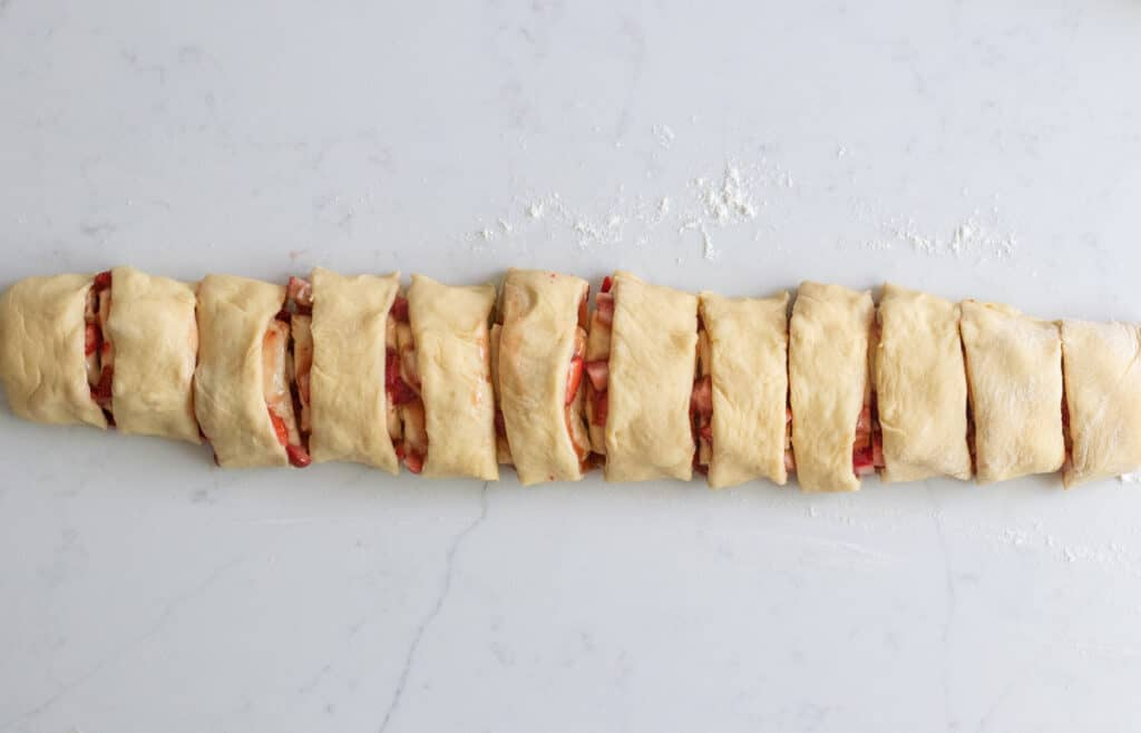 strawberry sweet rolls dough log cut into slices