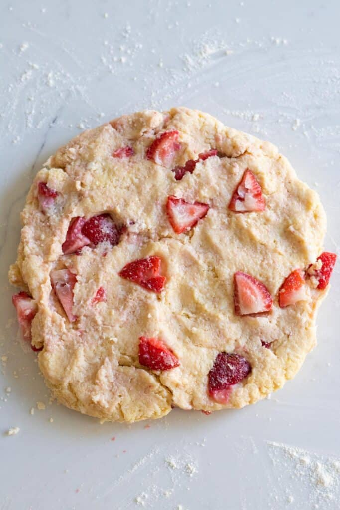 strawberry scone dough rolled into a circle