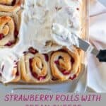 strawberry sweet rolls with frosting in pan