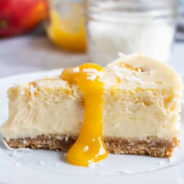 slice of mango cheesecake on plate