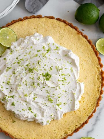 key lime tart with whipped cream and lime zest