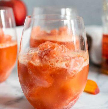close up of a glass with peach bourbon slush