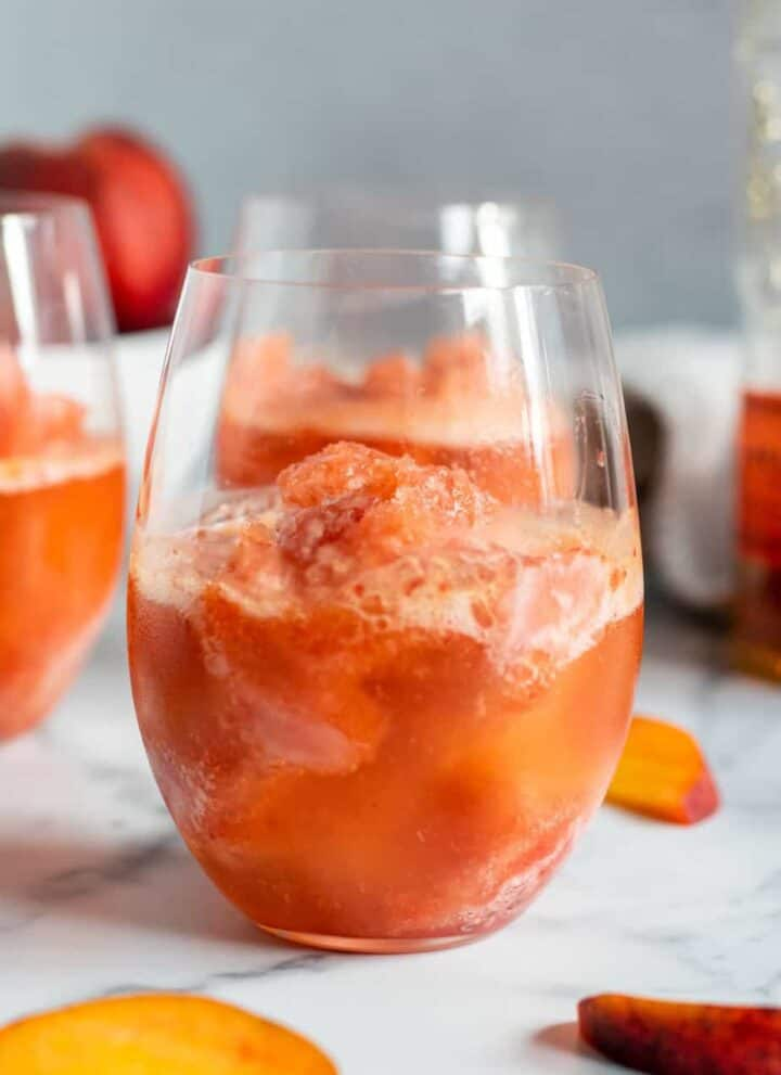 close up of a glass with peach bourbon slush