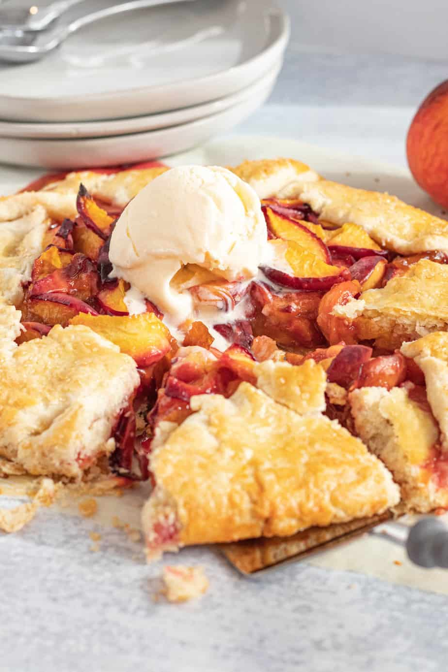 peach galette with scoop of vanilla ice cream