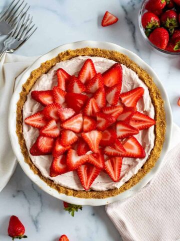 fresh strawberries atop a mousse pie