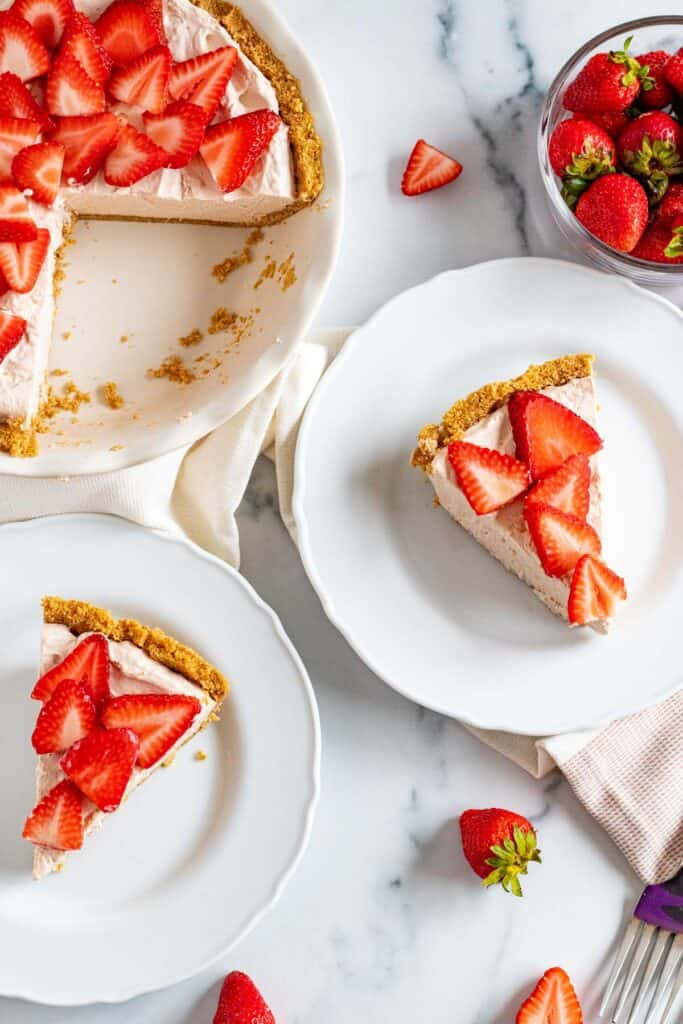 strawberry mousse pie in slices on white plates