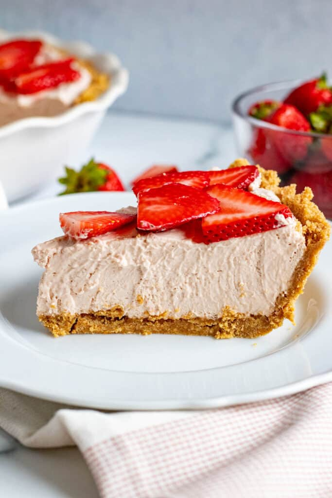 slice of strawberry mousse pie on a white plate