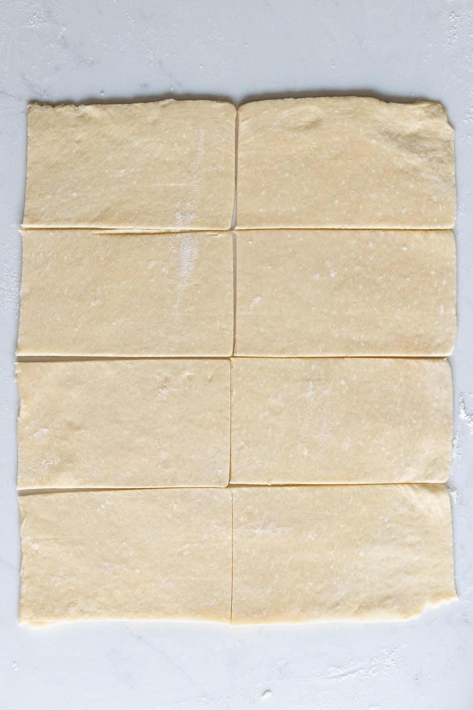 pie dough rectangle cut into 8 smaller rectangles