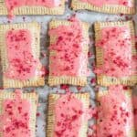 pop tarts with strawberry glaze on baking sheet