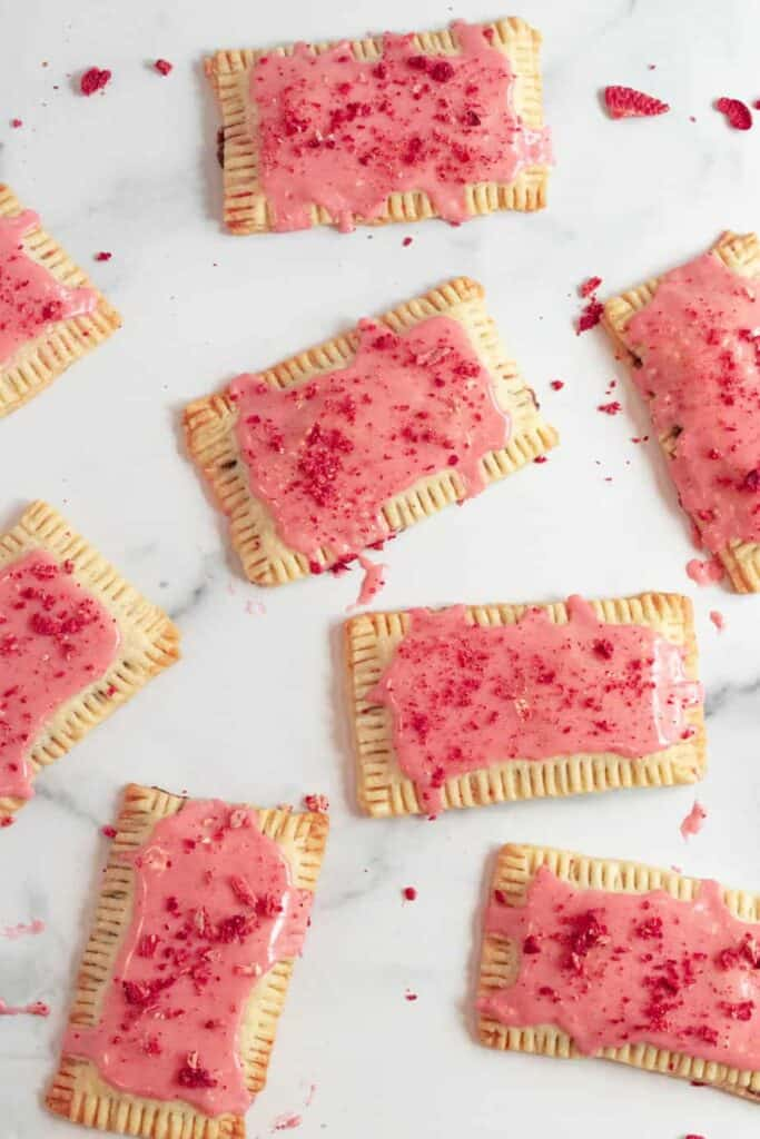 chocolate pop tarts with strawberry glaze on a white marble counter
