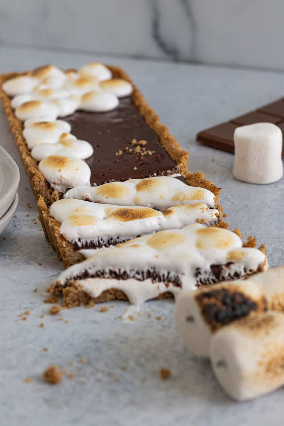 triangle shaped slices of s'mores tart with toasted marshmallow on top