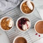 chocolate pots de cremes in white ramekins with pretzel crumble or bourbon cherries on top