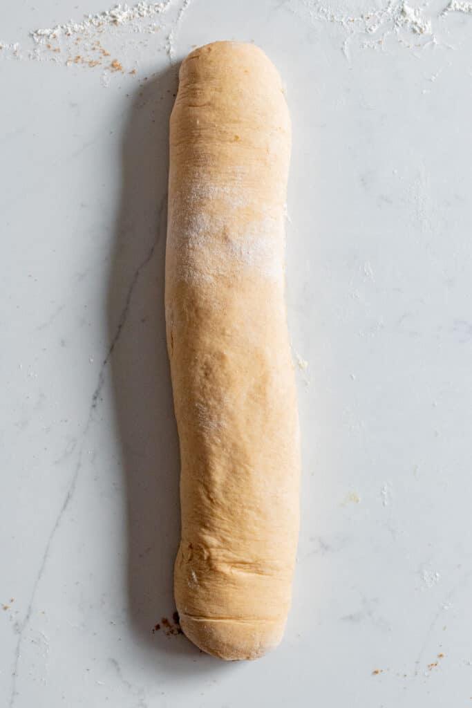 babka dough rolled up into a log
