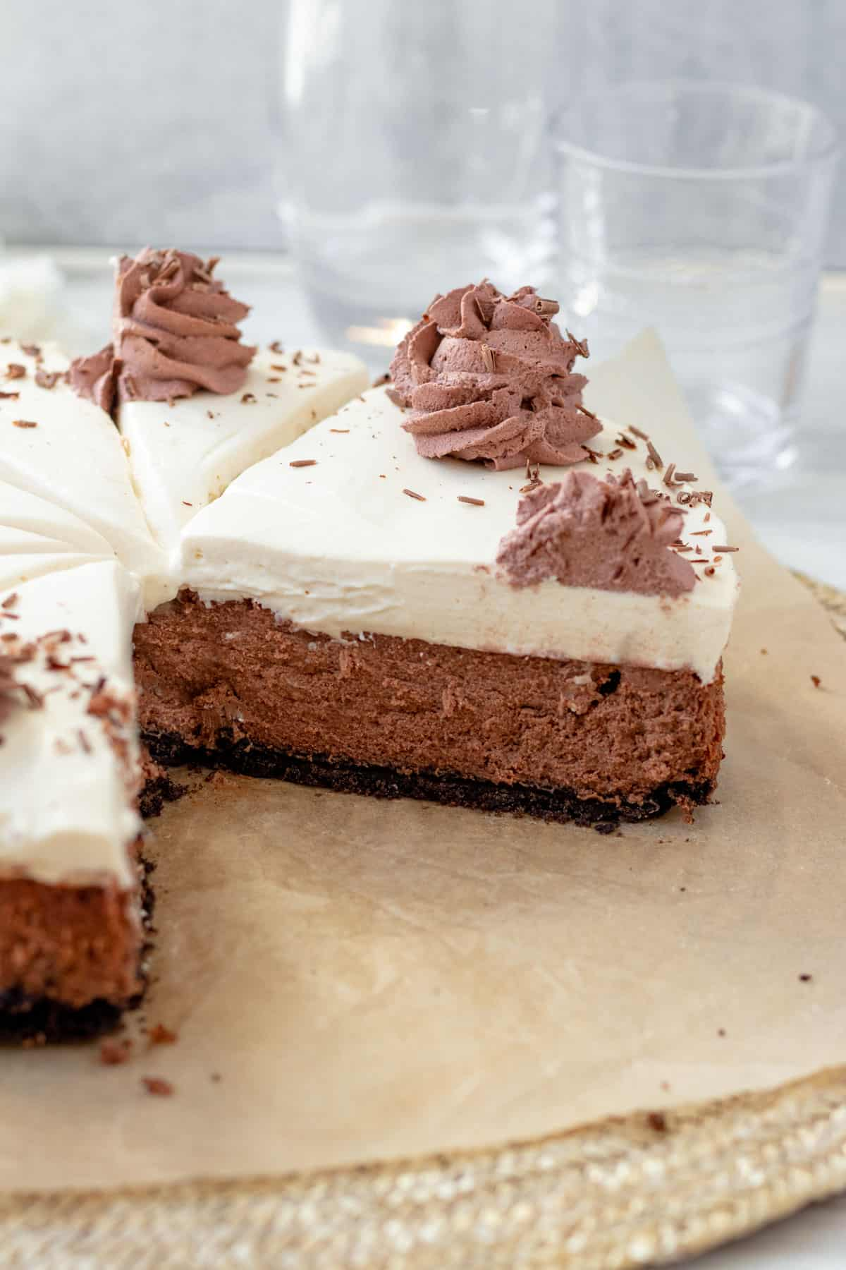 chocolate baileys cheesecake with layer of baileys mousse, sliced and looking at inside view