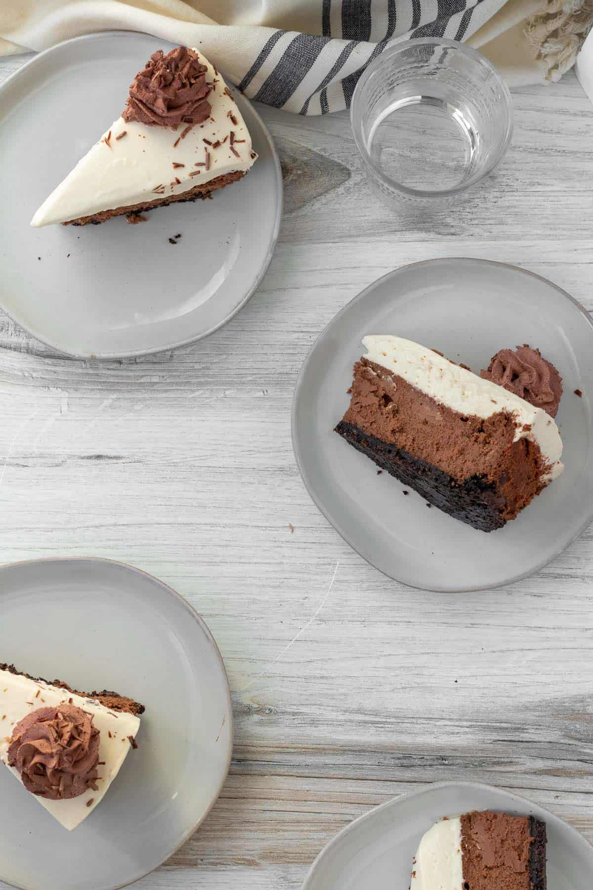 plates of individual slices of chocolate Baileys cheesecake