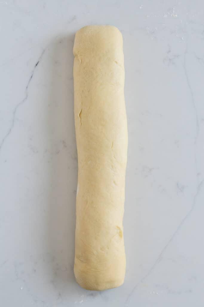 babka dough rolled into long log