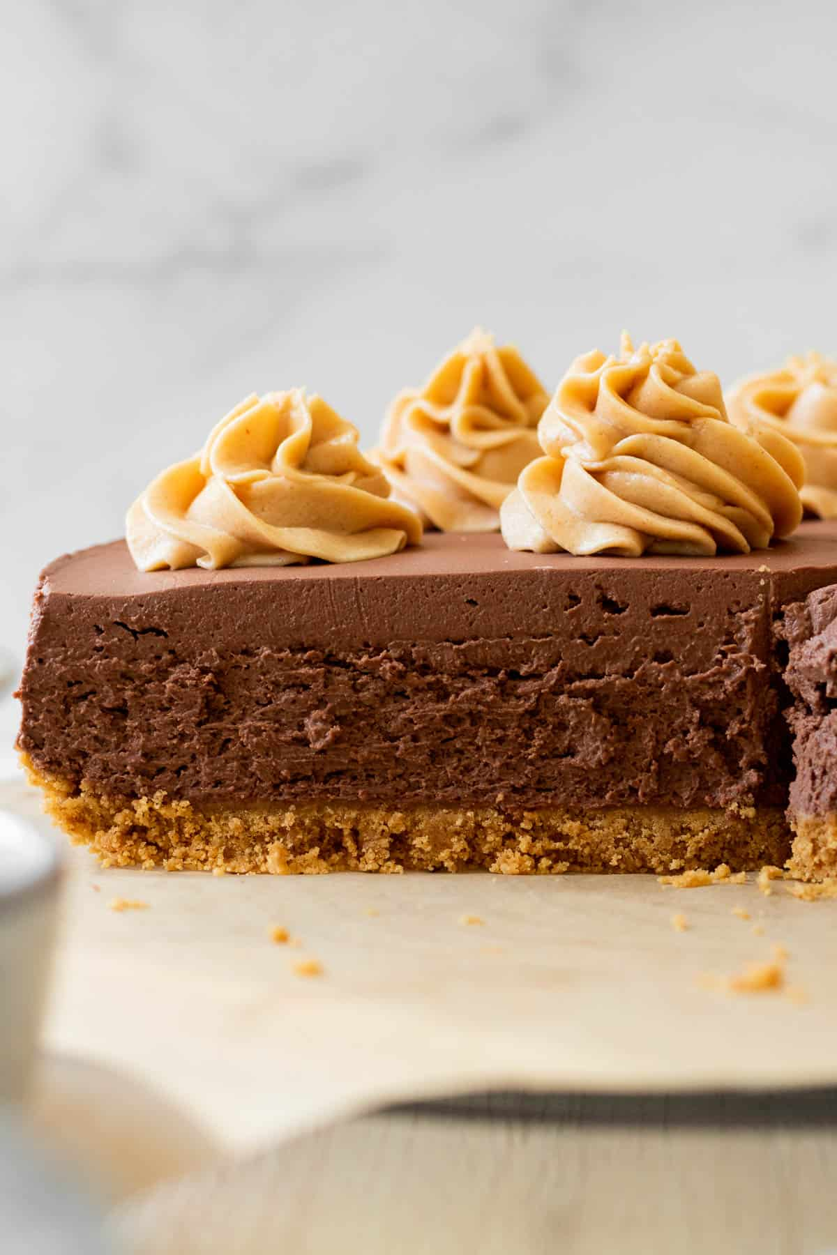 sliced chocolate cheesecake with peanut butter swirls on top