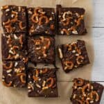 brownies topped with salted caramel and pretzels cut into squares